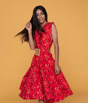 Model in thin red average-size yet lightweight dress with yellow pattern