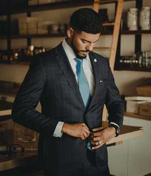 Model in darkgray suit with a hint of darkgray checkerboard pattern
