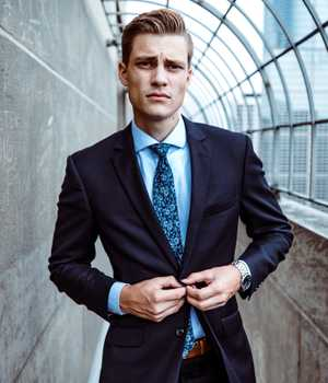 Model in tight but plain darkblue suit